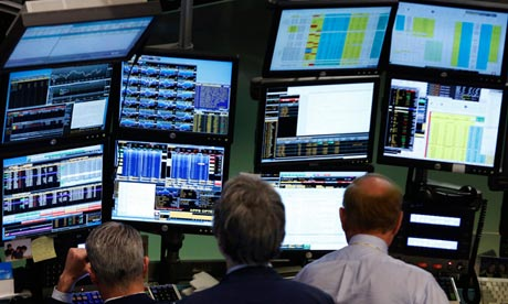 Traders work at Bloomberg terminals on the floor of the New York Stock Exchange